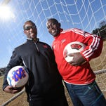 When asked who was the better dancer, Madison Central  soccer coach Cecil Hinds, left, and Brandon girls soccer coach Jeremy Shortt, both agreed it was Hinds, and after a pause, they struck this pose. The friendship has strengthened over the years and they will coach against one another in the high school ranks for the first time in the Class 6A championship on Saturday at Clinton High.