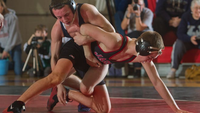 Kris Lindemann (left), shown wrestling Jackson Memorial's Hunter Reese in a 2013 NJSIAA Central Group IV semifinal, has helped Howell earn the No. 1 seed in the Shore Conference Tournament.