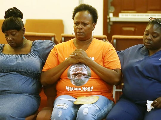 Renee Perkins, center, shares the story of her son's murder during a restorative healing meeting recently at the Followers of Christ Fellowship Ministries church in Fort Myers. Gwendora Baskin, left, and Deloria Dillard, right, also had sons murdered in Fort Myers.