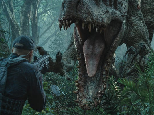 """This photo provided by Universal Pictures shows, Indominus Rex about to attack in a scene from the film, """"Jurassic World,"""" directed by Colin Trevorrow, in the next installment of Steven Spielberg's groundbreaking """"Jurassic Park"""" series. The Universal Pictures 3D movie releases in theaters on June 12, 2015. (ILM/Universal Pictures/Amblin Entertainment via AP)"""