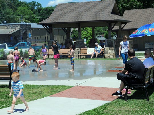 2014: Development of Black Mountain Town Square took several years at the start of the decade. Pictured here, kids cool off in June 2016 at the Rotary splash fountain.