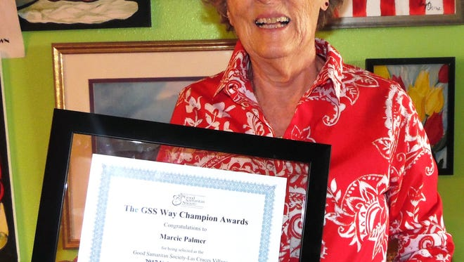 Marcie Palmer holding up her 2017 Award for Volunteer Champion