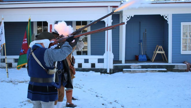 Members of the Gov. Isaac Shelby Chapter of the SAR gave a long-rifle salute for the opening of the newly renovated Oldham County History Center.