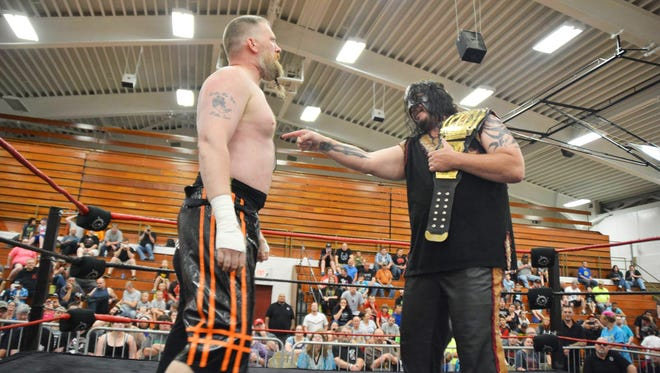 "Impact Wrestling star Abyss faces off with Toby Cline at the ASWA ""Eruption"" event in June 2016."