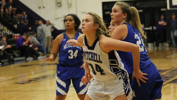 Morgan Buchanan boxes out for a rebound during a game