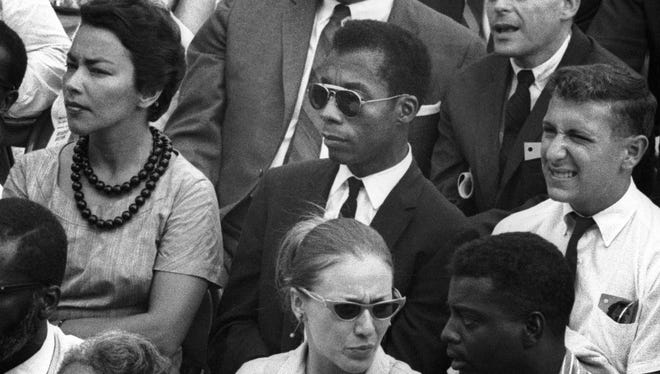 """Writer and social critic James Baldwin, center, was close with many of the most prominent figures of the civil rights era, including Medgar Evers, Malcolm X and Martin Luther King Jr. Material from his unfinished manuscript about the three men forms the basis for the film """"I Am Not Your Negro."""""""