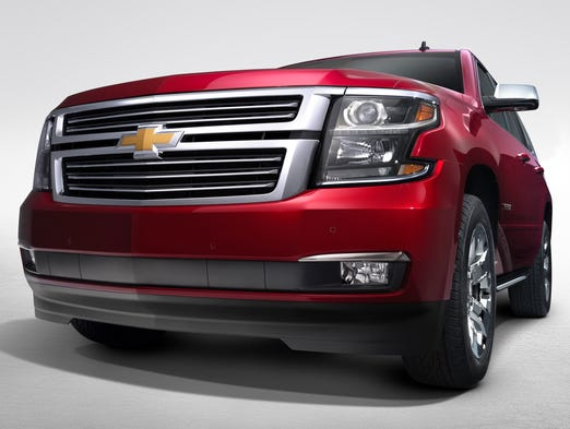 Chevrolet gave the front of the 2015  Tahoe a sleeker look. The new color is called crystal claret. The big SUV goes on sale first quarter next year.