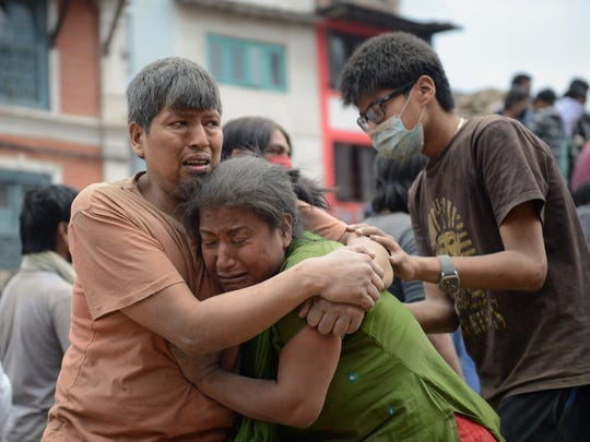 April 25, 2015: More than 2,500 dead in Nepal. A Nepalese man and woman hold each other in Katmandu's Durbar Square, a UNESCO World Heritage Site that was severely damaged by an earthquake on April 25, 2015.