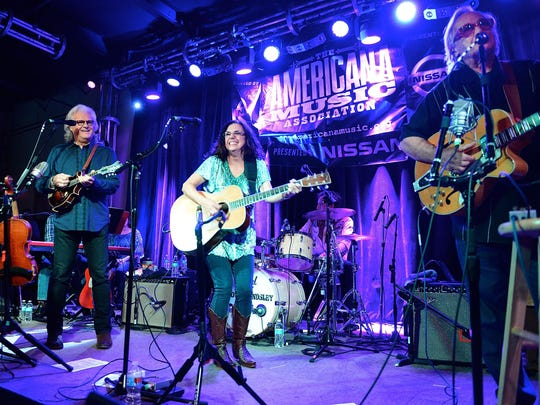 Ricky Skaggs, Sharon White, and Ry Cooder perform for the Americana Music Festival last September in Nashville, Tennessee.