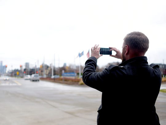 Jon Chezick snaps a photos of the Detroit skyline from