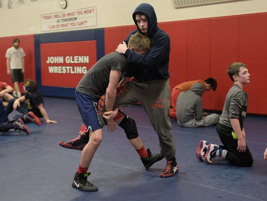 Mikey Mars practices with teammate Isaac Lefler during