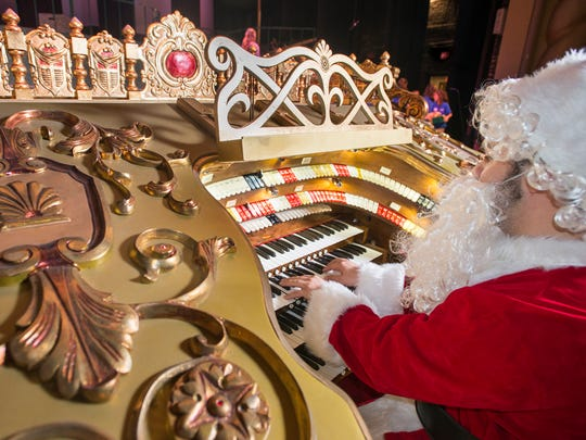 "Santa-clad artistic director Alex Gartner plays the newly refurbished vintage Robert Morton organ at the Saenger Theatre during the Pensacola Children's Chorus rehearsal on Wednesday, December 6, 2017.  The organ, that was installed as part of the Saenger's construction, will play a part in this year's ""Christmas on the Coast"" performance."