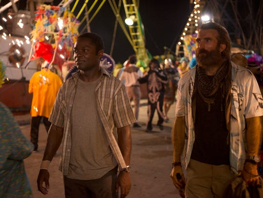 "David Oyelowo (left) and Sharlto Copley star in ""Gringo."""