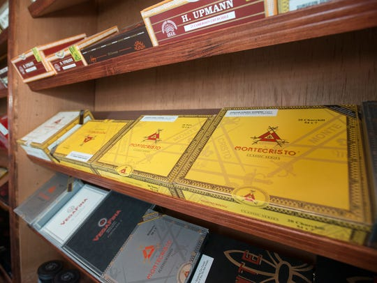 A large selection of cigars is housed in the walk-in