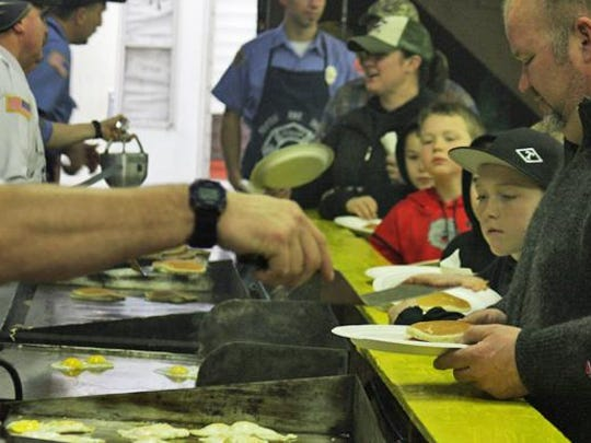 Hungry guests eye the goods at the Mehama Fire Station Sweetheart Benefit Breakfast