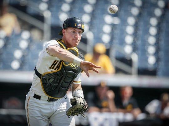 Iowa senior catcher Tyler Cropley throws the ball to