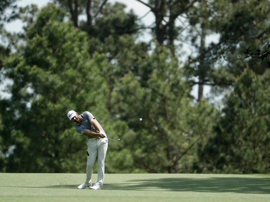 Dustin Johnson hits from the fairway on the 15th hole during practice for the Masters golf tournament at Augusta National Golf Club, Tuesday, April 3, 2018, in Augusta, Ga. (AP Photo/Matt Slocum)