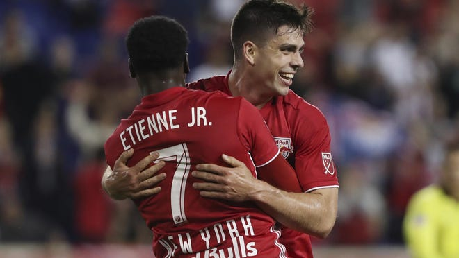 New York Red Bulls forward Brian White, right, hugs New York Red Bulls midfielder Derrick Etienne Jr. after scoring a goal during the first half of a match on May 22, 2019, in Harrison.