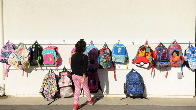 Sangana Vinoth, 6, puts away her backpack on the first day of kindergarten at Oak Hills Elementary. Oak Park Unified is the first public school district in Ventura County to go back to school.