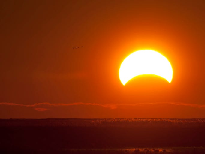 A View of the November 3rd 2013 Partial Solar Eclipse over the marsh at Bombay Hook National Wildlife Refuge near Smyrna. Photo by Charlie Long Jr.