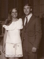 """Candy Philpot and Tim Hall pose for a photograph during Grad Night at Disneyland in June, 1970. They met in a Civics class in high school. """"She sat next to me,"""" he said. """"I was very shy."""" To get her attention, he kept dropping his pencil. """"She thought I was clumsy and finally I worked up enough nerve to ask her out."""" Ten years into their marriage, he admitted to her that he wasn't clumsy when they met. He was just trying to get a better look at her legs. They've been married almost 42 years."""