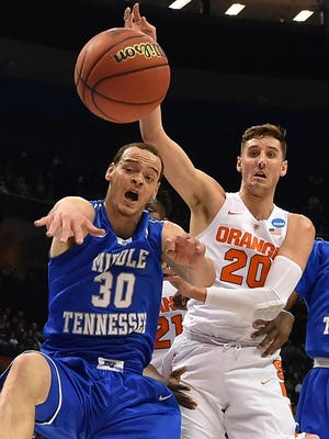 Middle Tennessee forward Reggie Upshaw (30) loses control of the ball as Syracuse forward Tyler Lydon (20) guards during the first half at Scottrade Center.