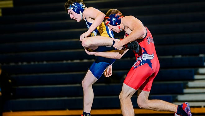 Brad Rinckey ,right, of Everett attempts a single leg take-down of Andreas Sigurani of Grand Ledge during their 145 lbs. finals match Wednesday February 8, 2017 in East Lansing.  Sigurani  would win by a fall.  KEVIN W. FOWLER PHOTO
