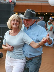 Sandy and Dan Eli dance on board StarVista's Country