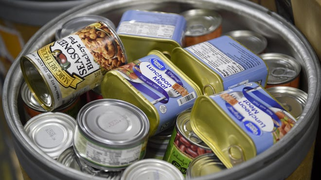 A barrel of food donated during a school food drive this year. Despite the COVID-19 pandemic and economic turmoil, Americans gave more to charities – especially donating food – this year.