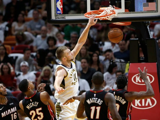 Indiana Pacers' Domantas Sabonis (11) dunks over Miami