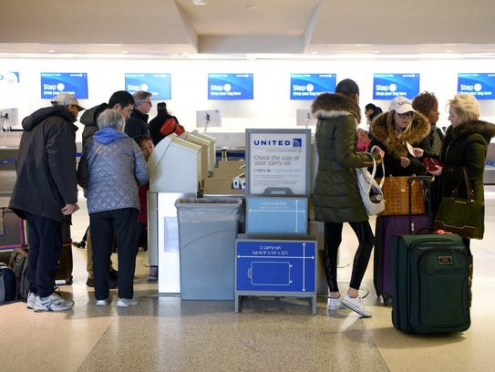 Passengers check-in for their flights on United Airlines