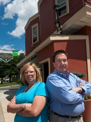 Jim Fischer, and Valerie Fischer co-owner's of the recently singed Tom Fischer's Tavern in Haddon Township, posed for a photo outside the building during the construction renovations in progress. The bar is expected to reopen later this month after a fire.