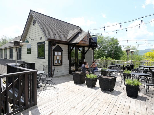 The outdoor dining deck at The Parish Restaurant on