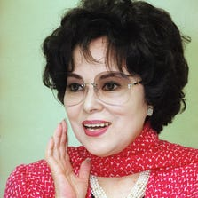 """September 7, 2014: Yoshiko Yamaguchi, is seen in an April 1991 file photo. The tale of Yamaguchi, known in the older generation as """"Rikoran,"""" a wartime screen star, is told in a musical to remind Japanese of their disastrous militarist past. Yamaguchi, who symbolized Japan's dreams of Asian conquest, has died at age 94."""