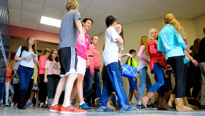 Students walk through the halls during a transition period Wednesday, Oct. 14, at Sartell Middle School. Students are experiencing crowded hallways because of space issues at the middle school.