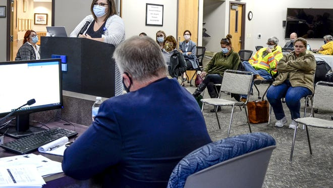 Colleen Drees, Finney County Health Department director, speaks about potentially enforcing a countywide mask mandate at Monday's Finney County Commission meeting. A motion to pass a mask mandate failed.