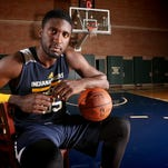 Indiana Pacer Roy Hibbert prefers to stay out of the limelight, away from the crowd, just keeping quiet and playing basketball.  Hibbert was photographed on the practice court at Bankers Life Fieldhouse on Monday, October 27, 2014.