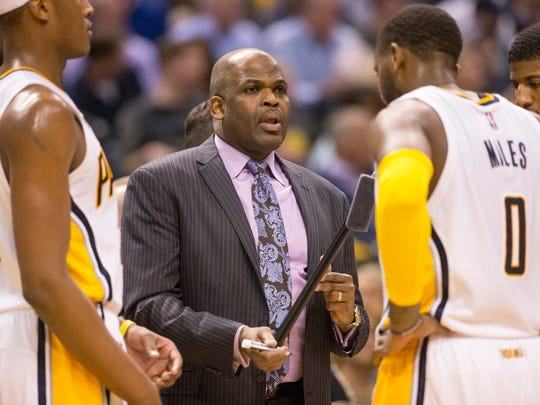 Nate McMillan, Head Coach of Indiana, talks strategy with his players near the end of the game Utah Jazz at Indiana Pacers, Bankers Life Fieldhouse, Indianapolis, Monday, March 20, 2017. Indiana won 107-100.