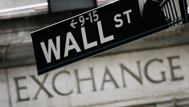A  sign hangs in front of the New York Stock Exchange.