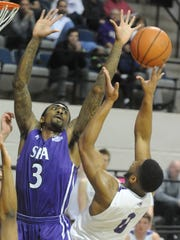 Stephen F. Austin's Leon Gilmore III (3) defends as