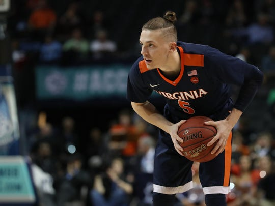 Virginia Cavaliers guard Kyle Guy (5) holds the ball