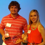 Austin Myers, of Campbell County, and Annie Heffernan, of St. Ursula, show off their hardware after the LaRosa's Hall of Fame Banquet.
