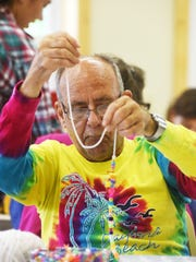Keith Hupfer does arts and crafts at Camp Echoing Hills.