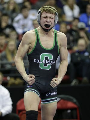 Coleman's Caleb Gross celebrates a win in the Division 3 120-pound championship during the WIAA individual state wrestling tournament Saturday at the Kohl Center in Madison.
