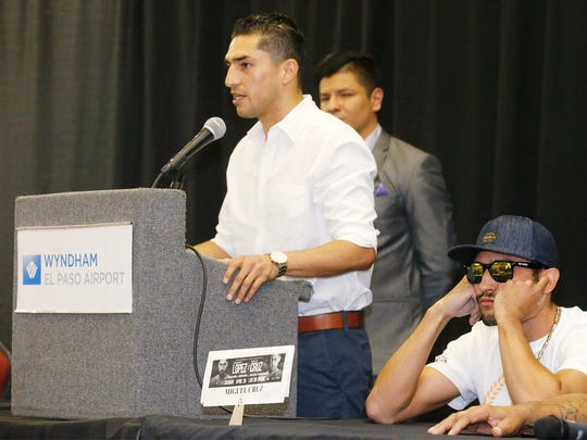 """Josesito Lopez, (at podium) addresses the crowd on hand as Miguel Cruz listens in during the press conference announcing their upcoming fight which will be held at the Don Haskins Center April 28. This is the second fight card that Premier Boxing Champions will bring to El Paso this year. El Pasoan Abraham """"Abie"""" Han will fight former world champion Anthony Dirrell in a 168 pound fight in the co-main event while Lopez and Cruz will be the featured fight of the night which will be televised on FOX and FOX Deportes nationally."""
