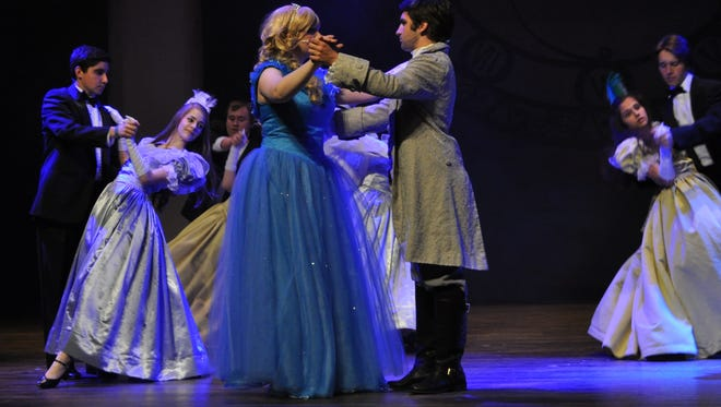Shira Kaplan, as Cinderella, dances with Bryan Deloach, the prince, during a rehearsal for Pineville High School Theatre's production of Rodgers and Hammerstein's Cinderella. The show opens Thursday and runs through Sunday.