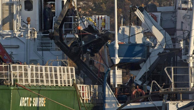 A Russian Investigation Committee inspects the Greenpeace International ship, Arctic Sunrise.