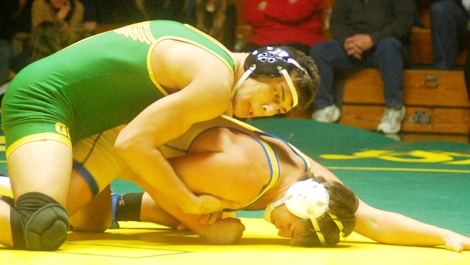 Queen of Peace sophomore Jacob Cardenas (top) taking on Lyndhurst/North Arlington's Nick Fernandez in the 182-pound battle Dec. 21.
