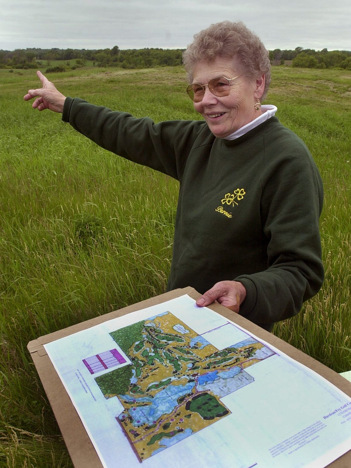 Bernice Millikin points to an area of her land that