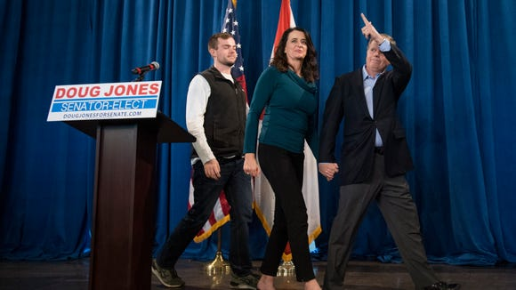 Senator elect Doug Jones exits with hisfamily after holding a day after election press conference in Birmingham, Ala. on Wednesday December 13, 2017.
